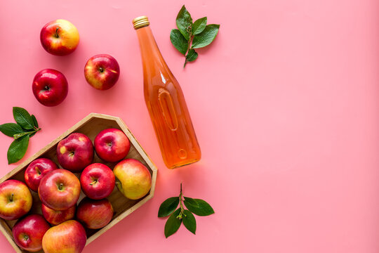 Apple cider vinegar in bottle with fruits top view