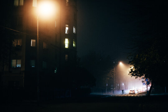 Foggy city street at night during autumn