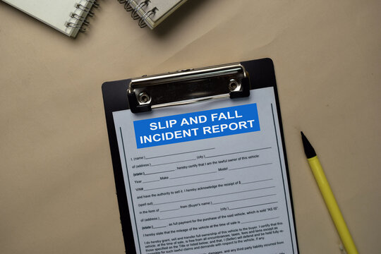Slip and Fall Incident Report write on a paperwork isolated on office desk.