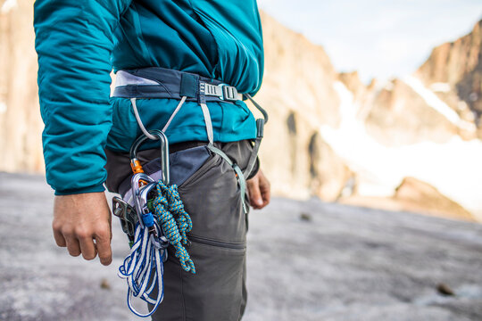 Side view of climbers harness and safety gear.