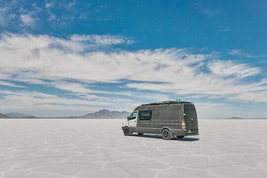 Camper van on Bonneville Salt Flats in Utah during a summer road trip.
