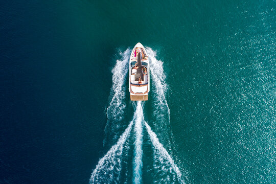 An aerial view of a group of friends power boating on Lake Tahoe, CA