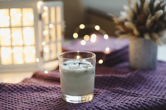 Organic scented soy candle in glass on the table. minimalism concept. Close up, copy space for text