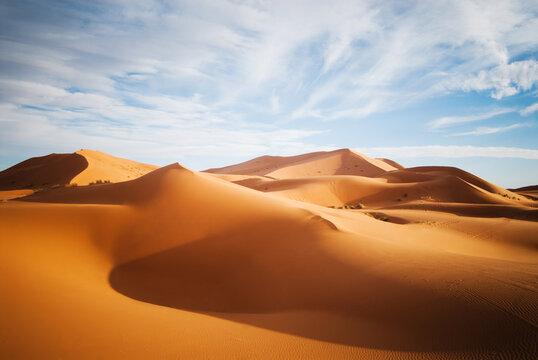 sand dunes in the Sahara Desert at sunset, Morocco..