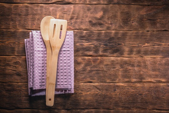 A kitchen towel and spatula on the kitchen table flat lay background with copy space.