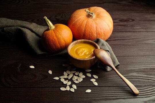Autumn pumpkin cream soup with pumpkin seeds