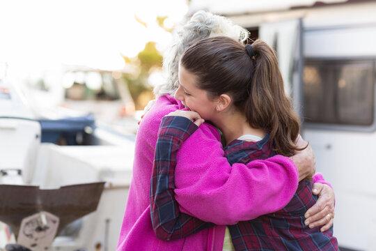 Teenager hugging her grandmother