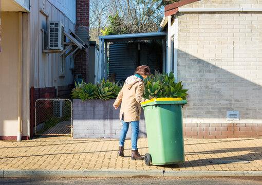 Resident taking recycling bin in off the street