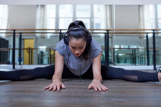 Young Maori dancer stretching at dance studio