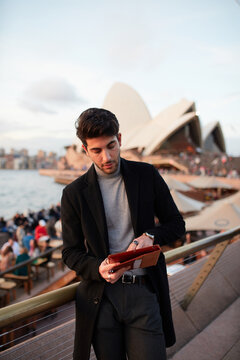 Tourist with the Sydney Opera House in background