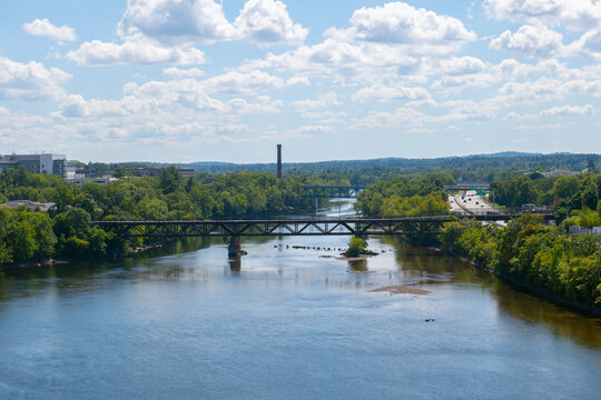 Aerial view of Merrimack River and Historic mill buildings near downtown Manchester, New Hampshire NH, USA.