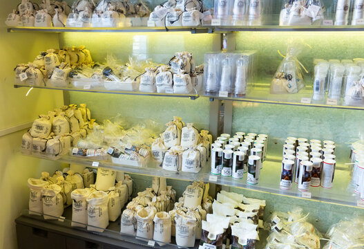 WIELICZKA, POLAND - MARCH 11, 2020: Variety of saltcellars and small bags with rock salt as souvenirs in store in Wieliczka salt mine
