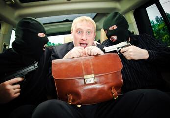 Fototapeta businessman grasped in hostages. obraz