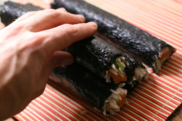 woman making california roll close-up