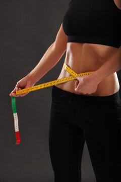 Measuring her slim waist