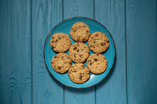 TOP VIEW: Cookies on a blue plate on a blue table
