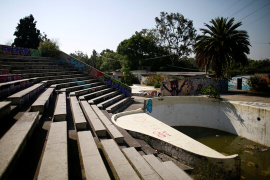 The remains of an abandoned dolphin show center, are seen inside the Bosque de Chapultepec as part of the project where Mexican artist, Gabriel Orozco will design, in Mexico City