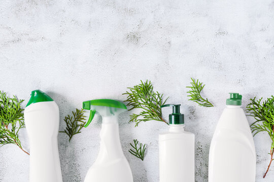 Set of different bottles of bio organic detergent  for home cleaning top view on grey concrete background.