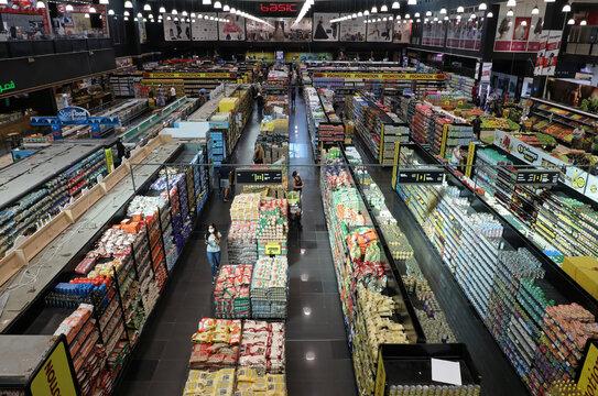 People shop inside a supermarket in the Jnah neighbourhood of Beirut