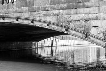 detail of an old berlin stone bridge in black an white