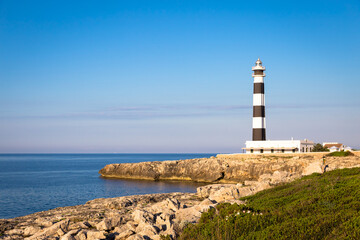 Wall Mural - Scenic Artrutx Lighthouse at sunset in Minorca, Spain
