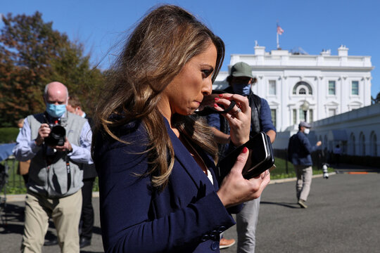 White House Director of Strategic Communications Farah puts on her mask after speaking to reporters about Trump's coronavirus disease (COVID-19), outside the White House in Washington