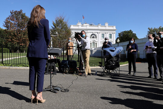 White House Director of Strategic Communications Farah speaks to reporters about Trump's coronavirus disease (COVID-19), outside the White House in Washington