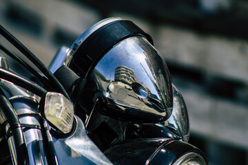 Fotomurales - Closeup of a motorcycle parked in the streets of the city center of the metropolitan area