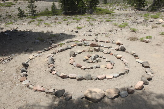A stone spiral laid out on the forest floor, Mount Shasta, Siskiyou County, California.