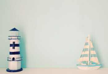 Lighthouse and ship model for decorated in room with retro filte