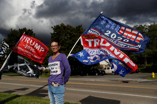 Shonna Bland, 45, owner of  the Top Notch Diner, poses in front of flags supporting U.S. President Donald Trump in Cortland, Ohio