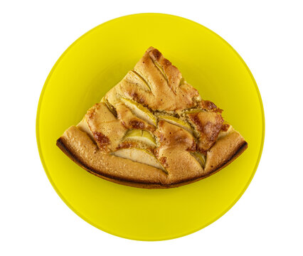 Piece of apple pie on yellow plate isolated on white. Top view