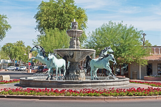 A bronze horse fountain situated in a central square in Old Town Scottsdale, Arizona.