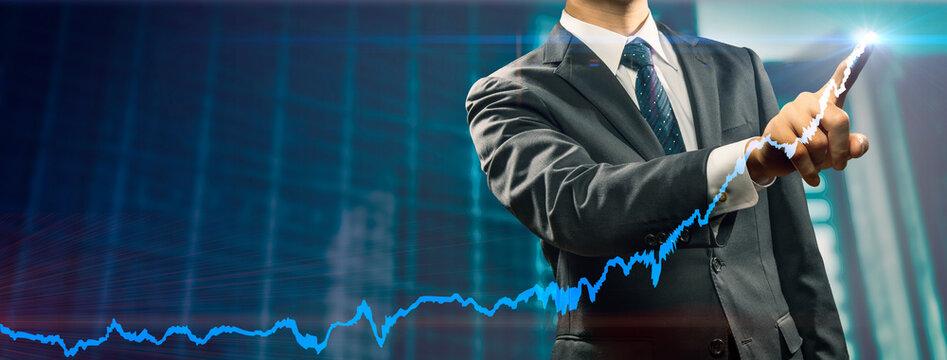 右肩上がりのグラフを表現したビジネスマンのイメージビジュアル