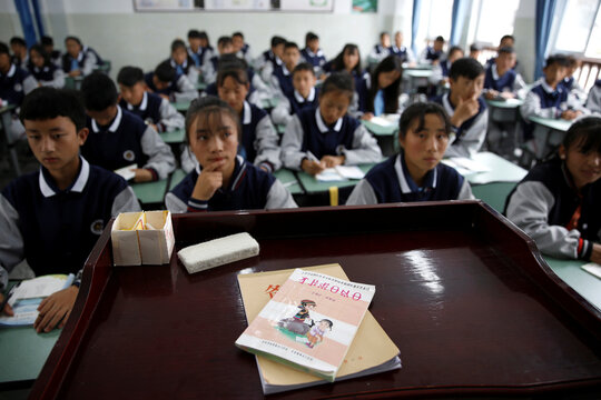 Textbook in ethnic Yi language is pictured during a class at the Wenchang Middle School in Yuexi