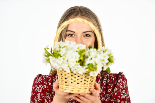 Impossible scent. girl at flower shop. natural gift. happy woman carry flowers in basket. spring blossom arrangement. beautiful summer bloom. female florist designer. womens and mothers day
