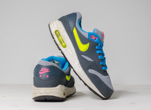 london, englabnd, 05/08/2018 Rare Nike Air max 1 gs Grey  blue and neon Nike air max retro classic sneaker trainers. Nike sport and street wear fashionable athletic apparel.