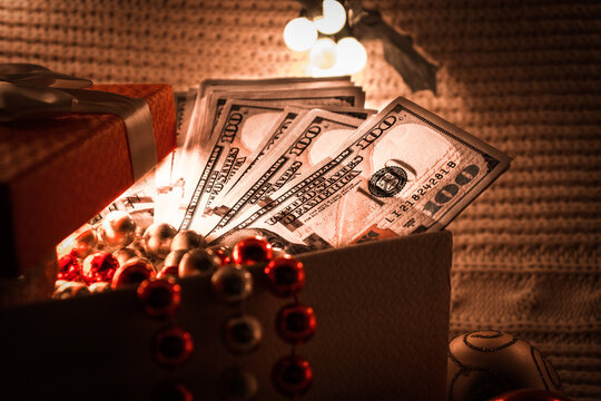 money in a Christmas gift box