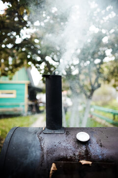 Outdoor barbecue grill. The smoke from cooking rises into the sky