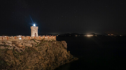 piombino livorno lighthouse on the promontory illuminated at night