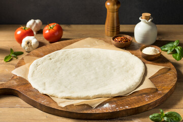 Preparing Homemade Uncooked Cheese PIzza