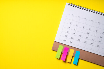 Photo sur Plexiglas Dinosaurs close up of calendar on the yellow table background, planning for business meeting or travel planning concept