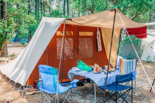 Large tent on campground in forest