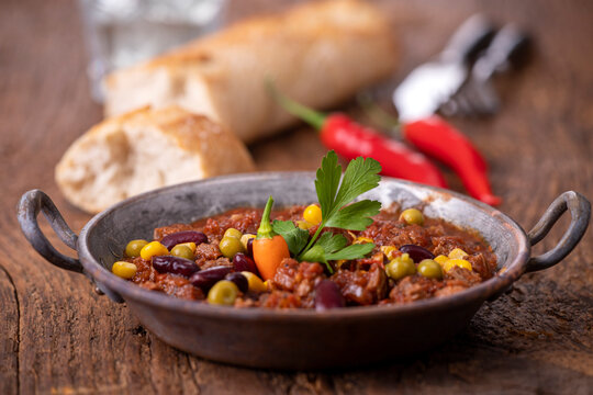 chili con carne on wood