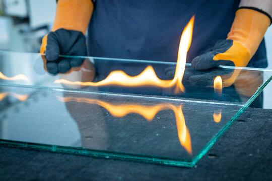 Cutting laminated glass, Burning through the foil connecting the glass panes