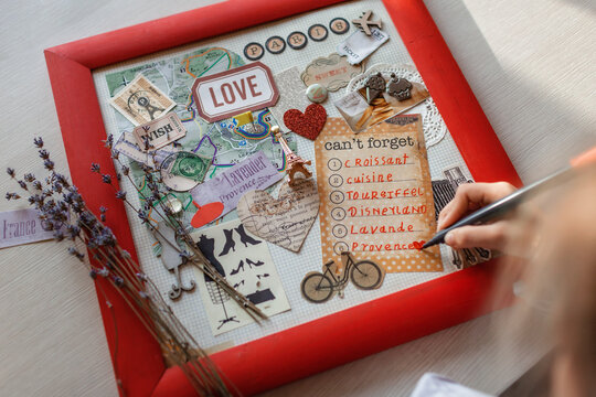 Cute girl dreaming about travel to France and creating mood board, positive thinking