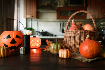 Domestic Halloween party with pumpkins on tabletop and blurred kitchen as backdrop. Fotobehang