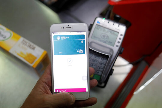A shopper uses the mobile payment service Apple Pay at a supermarket, amid the coronavirus disease (COVID-19) outbreak, in Ronda