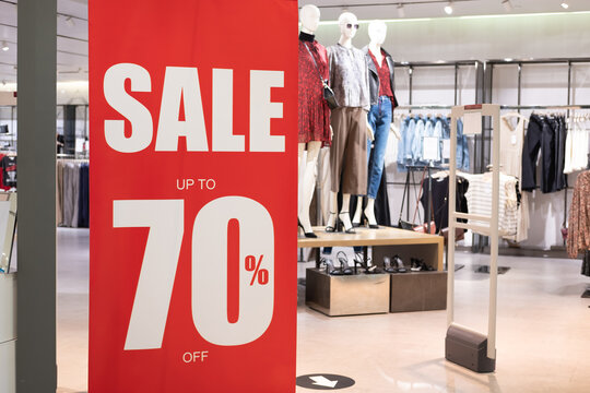 Big red sale 70% sign to draw attention of customer in front of women clothing store. Year of end or Black Friday sale period that department store has lots of discount for all products.