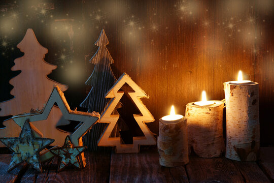 Christmas card with candles, stars and wooden trees, copy space